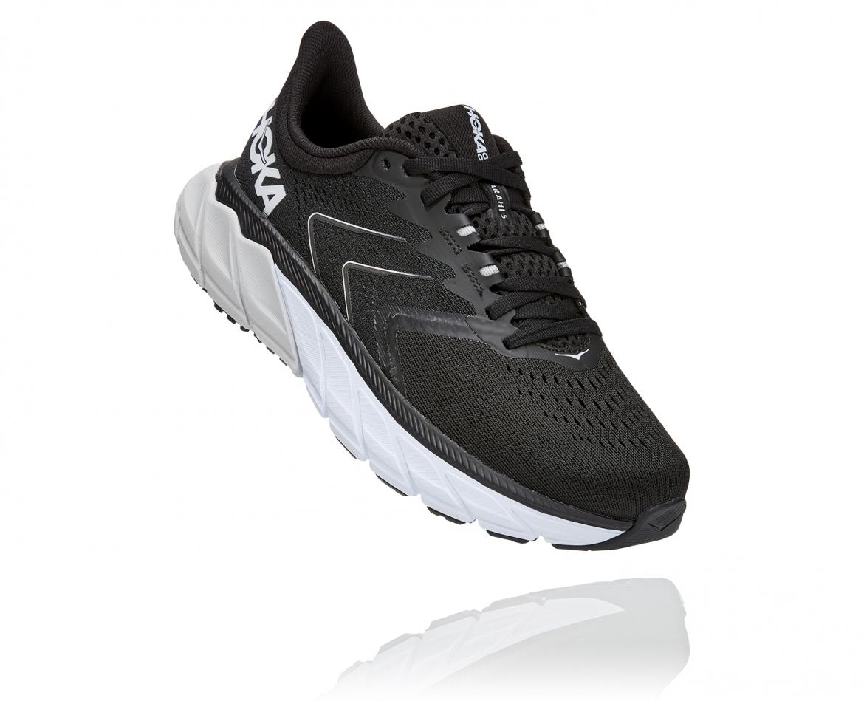 Hoka Arahi Wide 5 - נעלי ספורט נשים הוקה ארהי 5 רחבות בצבע שחור/לבן #1